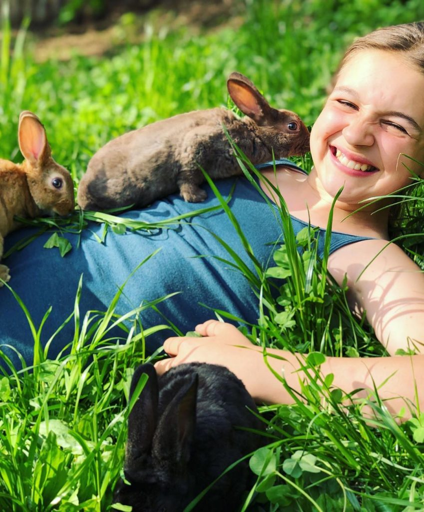 rabbits with child smiling