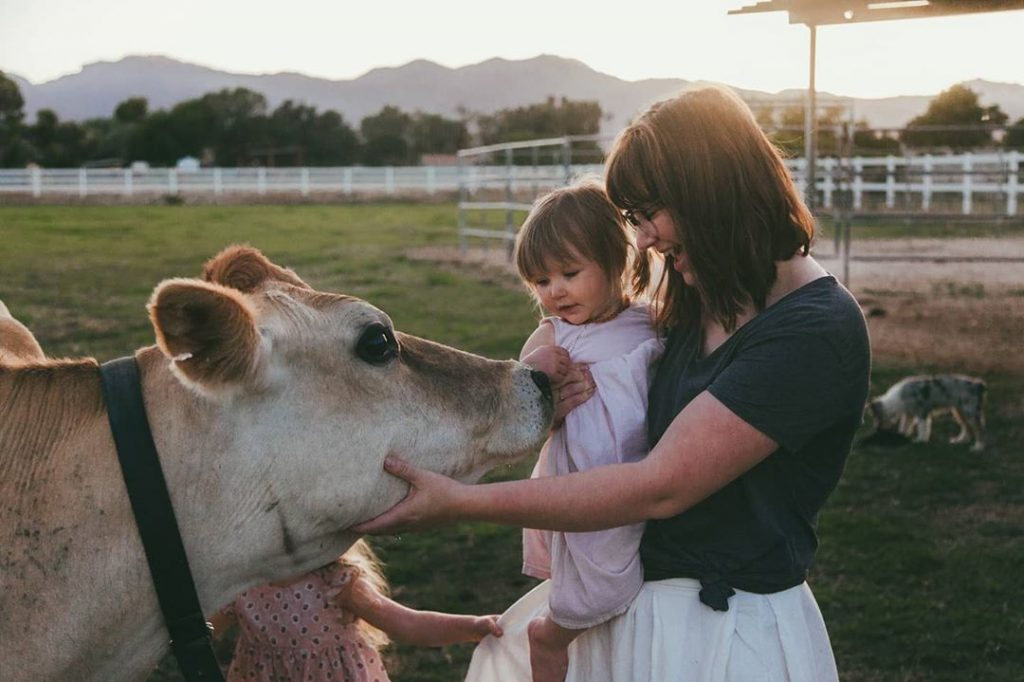 mom and children with cow