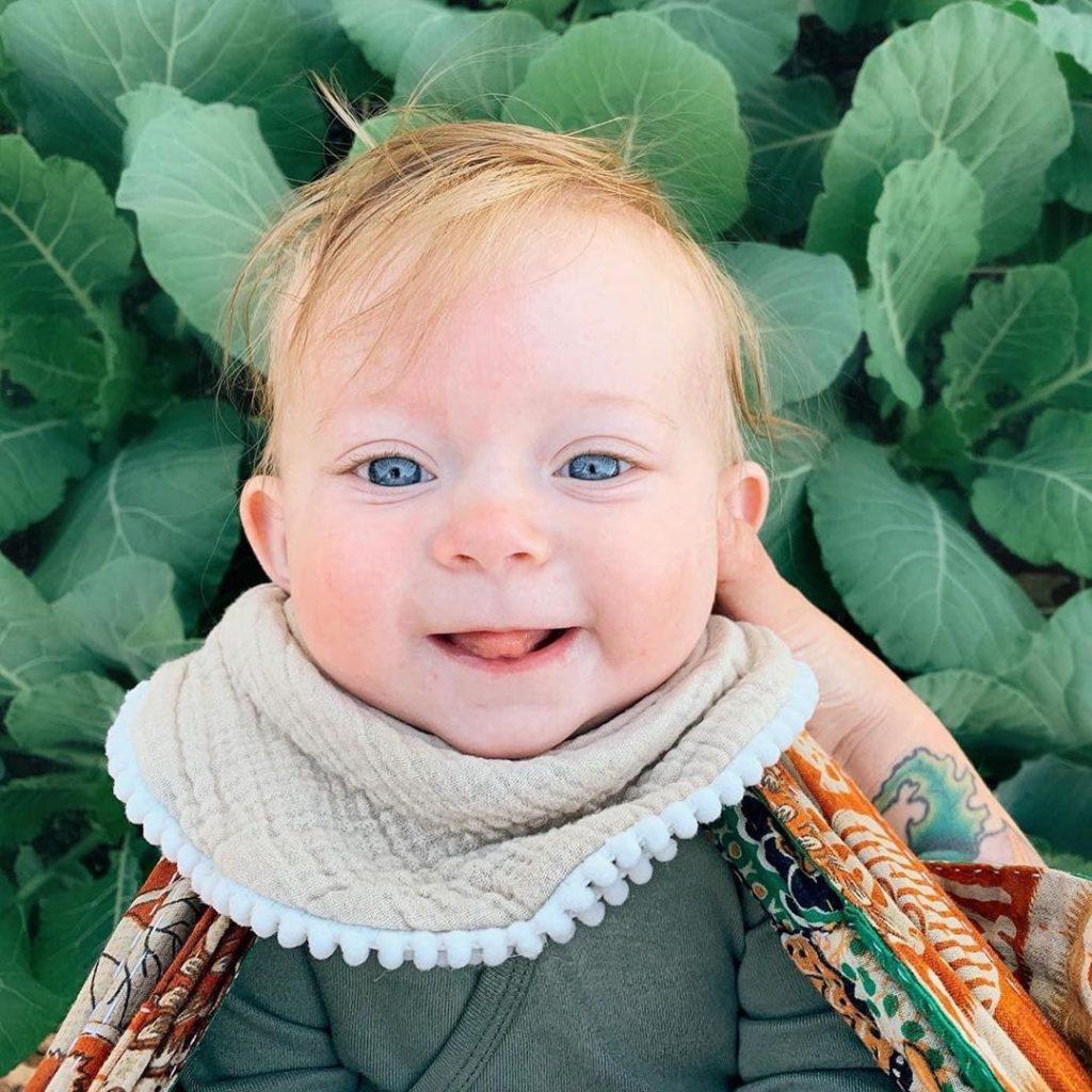 smiling baby in garden